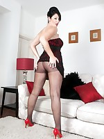 Busty, brunette Shay in black pantyhose action on the sofa!