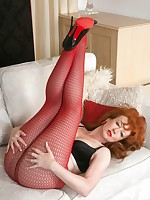 Mature kinkster Red in red fishnet and sheer pantyhose!