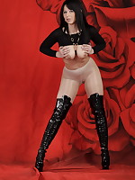 Milf Desyra in a bodysuit pantyhose and thigh high Boots