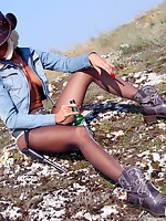 Leggy cowgirl teases in shiny dark pantyhose