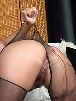 Taylor teasing in her black sheer pantyhose and mini dress!
