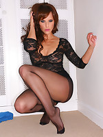 Sexy brunette in black lace body and black pantyhose strips nude.