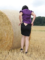 Pantyhose Diva posing in a golden field