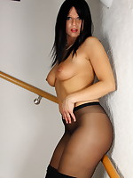 Attractive Pantyhose Diva posing in her black dress