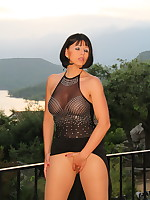 Pantyhose Diva posing on a balcony