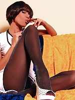 Long-legged lady in sparkling pantyhose teases with cigar