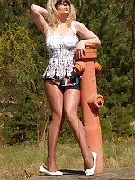 Angel at fire hydrant in shiny pantyhose
