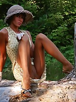 Sexy lady shows long yummy legs in vintage nylons outdoor