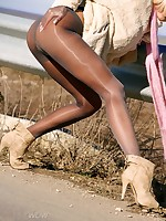 Horny MILF in shiny pantyhose offers sex for money on the road